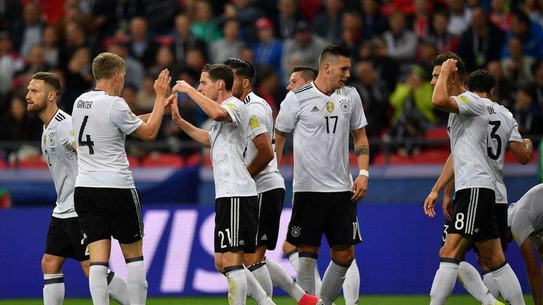 Germany's midfielder Lars Stindl (R) celebrates with teammates
