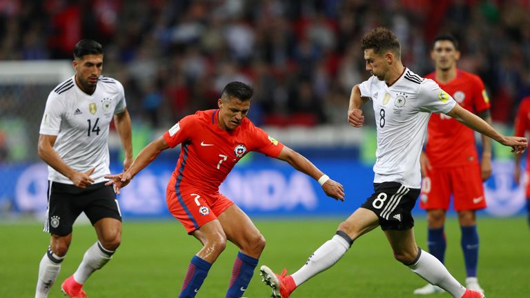 KAZAN, RUSSIA - JUNE 22: Alexis Sanchez of Chile and Leon Goretzka of Germany battle for possession during the FIFA Confederations Cup Russia 2017 Group B