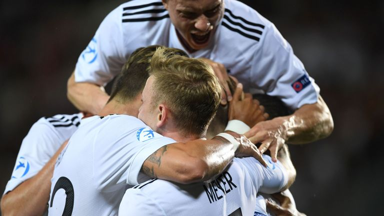 Mitchell Weiser is congratulated after his strike in the European U21 Championship final