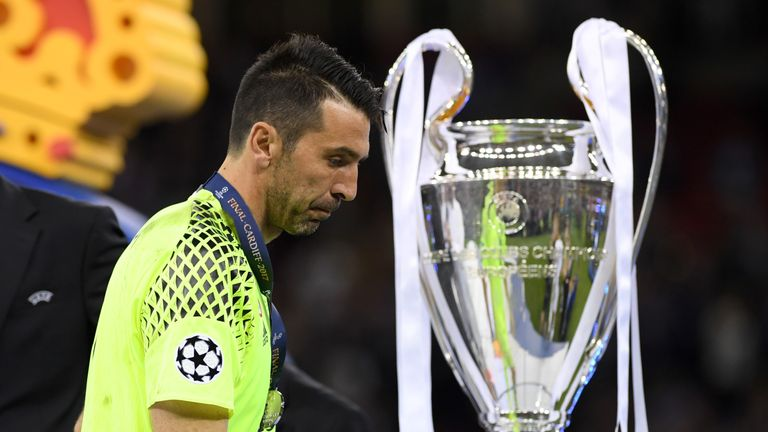 CARDIFF, WALES - JUNE 03:  Gianluigi Buffon of Juventus walks past the Champions League trophy after the UEFA Champions League Final between Juventus and R