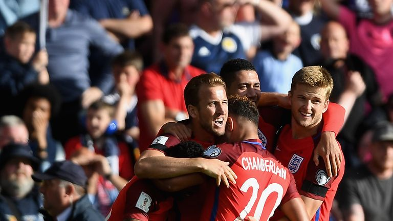 Harry Kane of England celebrates scoring his side's second goal with his team-mates during the FIFA 2018 World Cup Qualifier v Scotland at Hampden