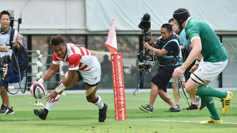 Japan's center Kotaro Matsushima scores their first try