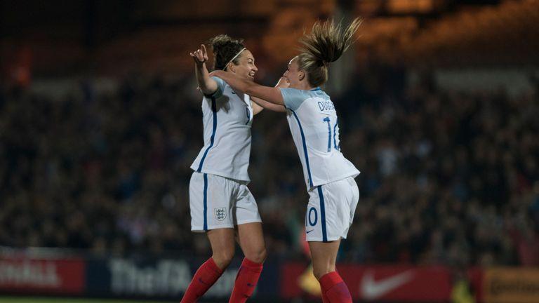 Jodie Taylor of England celebrates with Toni Duggan