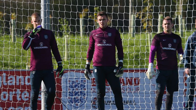 Joe Hart, Jack Butland and Tom Heaton of England look on during the England training session at St Georges Park o