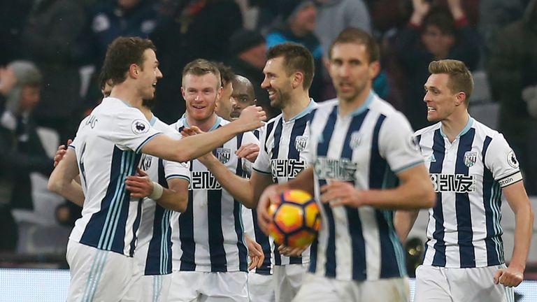 West Bromwich Albion's Northern Irish defender Jonny Evans (L) and West Bromwich Albion's Northern Irish defender Gareth McAuley (C) celebrate their late e