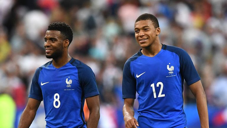 France's forward Thomas Lemar (left) and Mbappe react following their 3-2 win over England