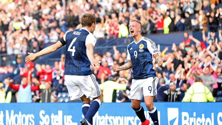Scotland's Leigh Griffiths (right) celebrates scoring his side's second goal of the game during the FIFA World Cup qualifying, Group F match v England