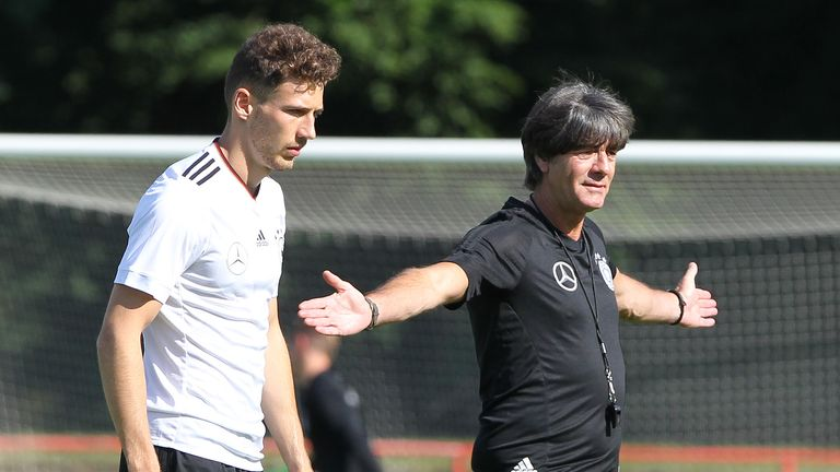 Germany's head coach Joachim Loew (R) gestures in front of Germany's defender Leon Goretzka during a training session during their preparation for the FIFA