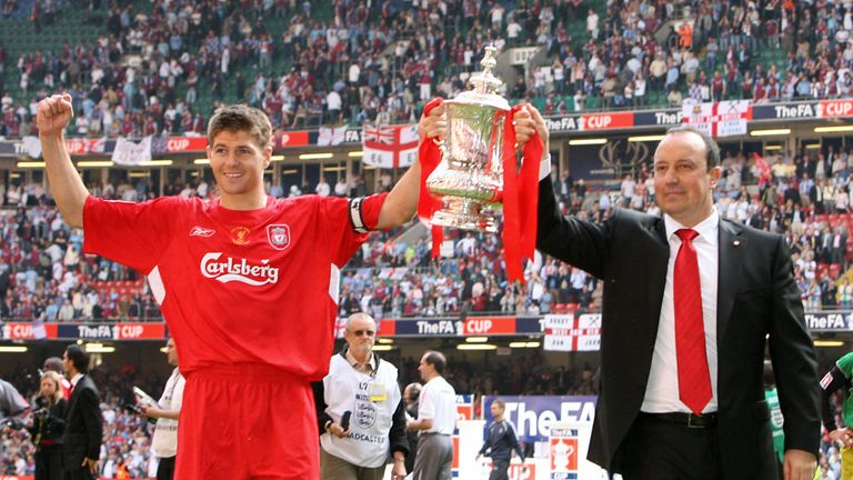 CARDIFF, United Kingdom:  Liverpool manager Raphael Benitez (R) and captain Steven Gerrard lift the FA Cup after Liverpool beat West Ham 3-1 on penalties