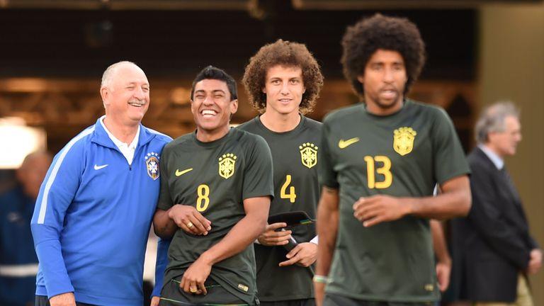 (FromL) Brazil's coach Luiz Felipe Scolari, Brazil's midfielder Paulinho
