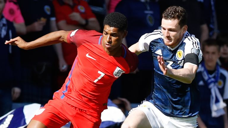 England's Marcus Rashford (left) and Scotland's Andrew Robertson battle for the ball during the 2018 FIFA World Cup qualifying, Group F match at Hampden