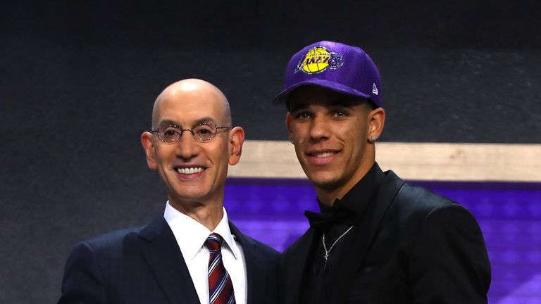 Lonzo Ball walks on stage with NBA commissioner Adam Silver after being drafted second overall by the Los Angeles Lakers