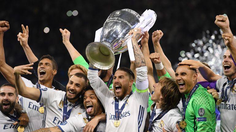 CARDIFF, WALES - JUNE 03:  Sergio Ramos of Real Madrid lifts The Champions League trophy after the UEFA Champions League Final between Juventus and Real Ma