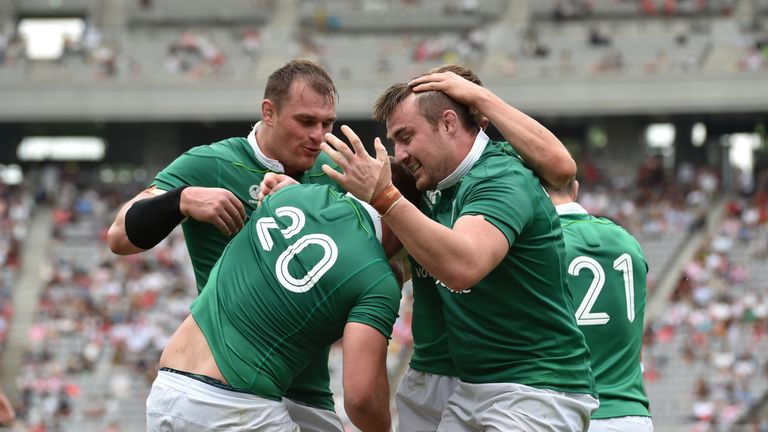 Sean Reidy  (20) is congratulated after scoring Ireland's fifth try