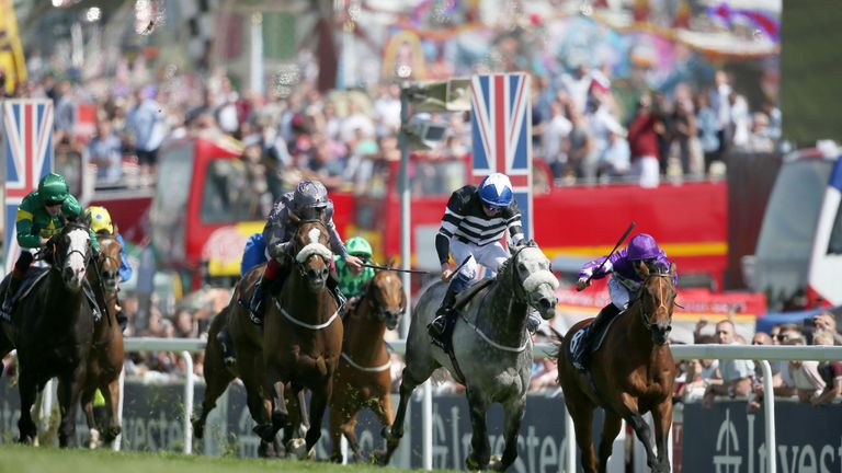 Sovereign Debt ridden by Jockey James Sullivan (centre) wins the Investec Diomed Stakes on Derby Day 2017