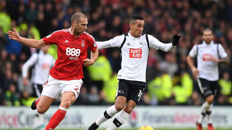 Tom Ince (R) and Pajtim Kasami battle for possession during a Sky Bet Championship match on December 11, 2016