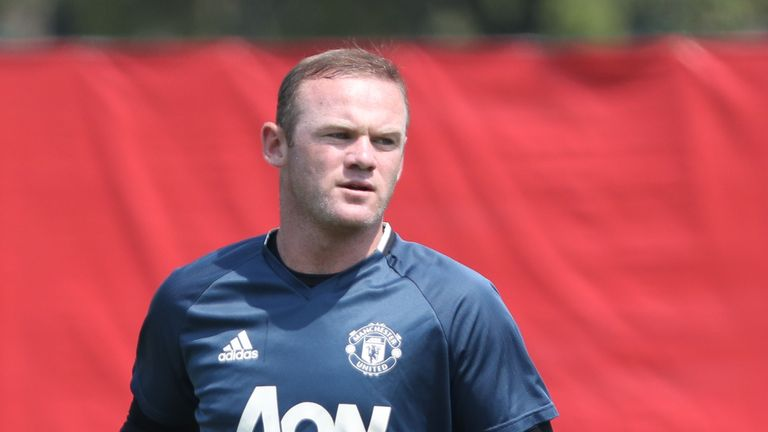 Ryan Giggs believes Wayne Rooney may stay at Manchester United beyond this summer