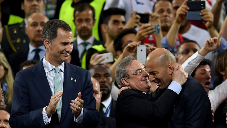 MILAN, ITALY - MAY 28: King Felipe VI of Spain looks on as Head coach Zinedine Zidane of Real Madrid is congratulated on winning the Champions League by Re
