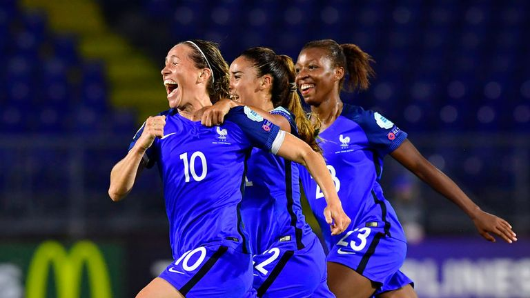France's midfielder Abily Camille (L) celebrates with team-mates after scoring