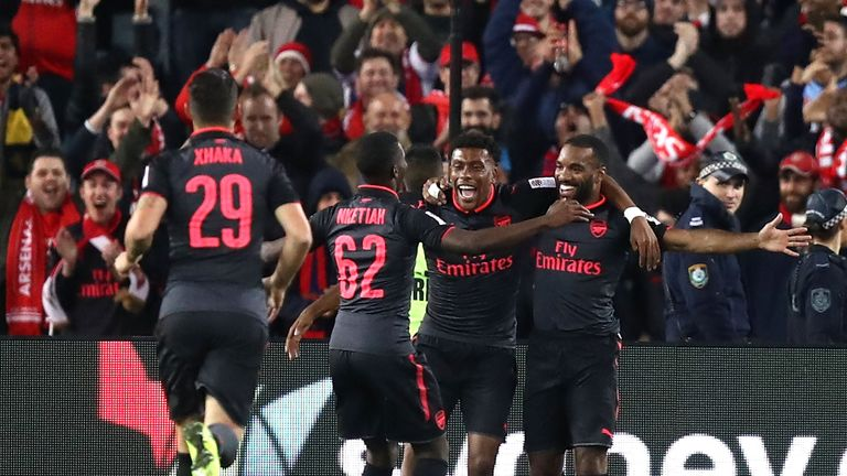 Alexandre Lacazette (far right) is congratulated by team-mates after scoring his first Arsenal goal