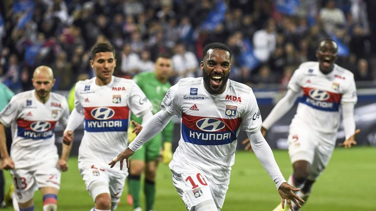 Alexandre Lacazette celebrates after scoring his 100th goal in Ligue 1 during a match between Lyon and OGC Nice