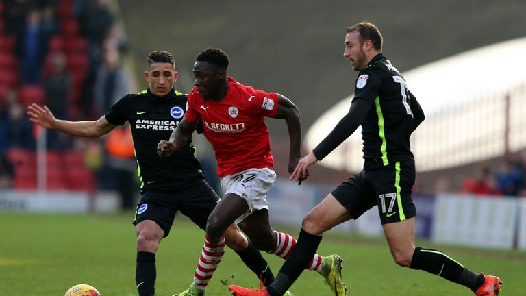BARNSLEY, ENGLAND - FEBRUARY 18:  Andy Yiadom(C) of Barnsley challenged by Anthony Knockaert (L) and Glenn Murray of Brighton & Hove Albion during the Sky