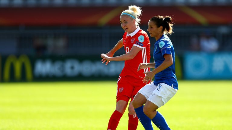 Daniela Stracchi (right) of Italy and Anna Cholovyaga of Russia compete for the ball during the Group B match