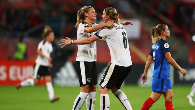 UTRECHT, NETHERLANDS - JULY 22:  Katharina Schiechtl and Carina Wenninger of Austria celebrate the final whistle after the Group C match between France and