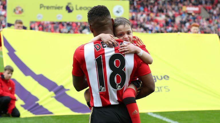 Defoe (L) held Bradley when he played for Sunderland