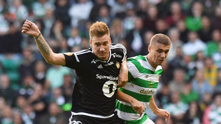 Rosenborg's Nicklas Bendtner (left) battles with Celtic's Jozo Simunovic, Champions League qualifying