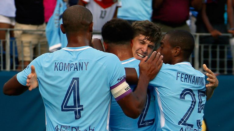 NASHVILLE, TN - JULY 29:  John Stones #5 of Manchester City is congratulated by teamates Vincent Kompany #4 and Fernandinho #25 after scoring a goal agains