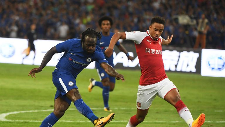 Chelsea's Victor Moses shoots for goal as Arsenal's Cohen Bramall challenges during their friendly football match at Beijing's National Stadium, known as the Bi