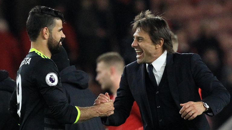 Chelsea's Italian head coach Antonio Conte (R) reacts as he congratulates Chelsea's Brazilian-born Spanish striker Diego Costa following the English Premie