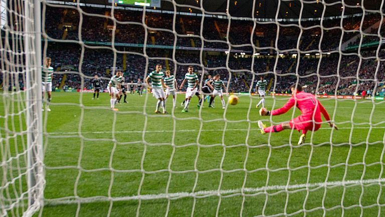 Celtic keeper Craig Gordon (pink jersey) makes a crucial late stop with his left boot