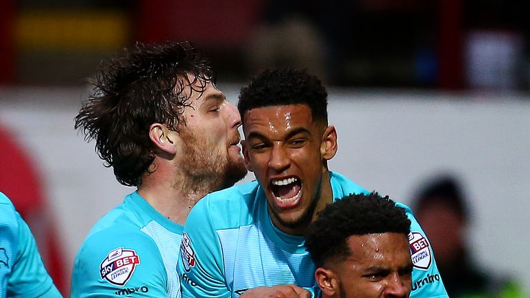 Cyrus Christie celebrates with teammates after scoring Derby's second goal during a 3-1 win over Brentford