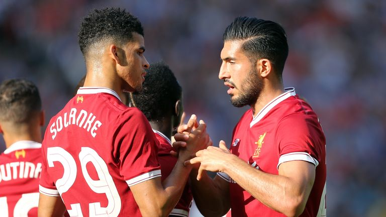 Dominic Solanke celebrates with Liverpool team-mate Emre Can