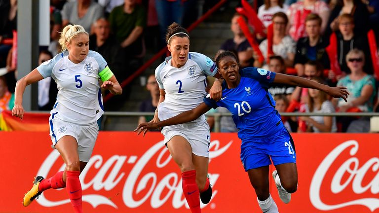 England's defender Stephanie Houghton (L) and England's defender Lucia Bronze vie with France's forward Kadidiatou Diani (R) during the UEFA Women's Euro 2