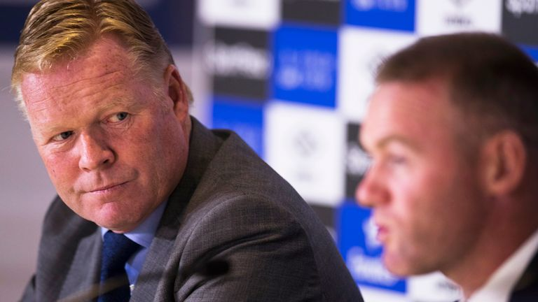 Ronald Koeman looks to Wayne Rooney while he speaks during a press conference at Goodison Park
