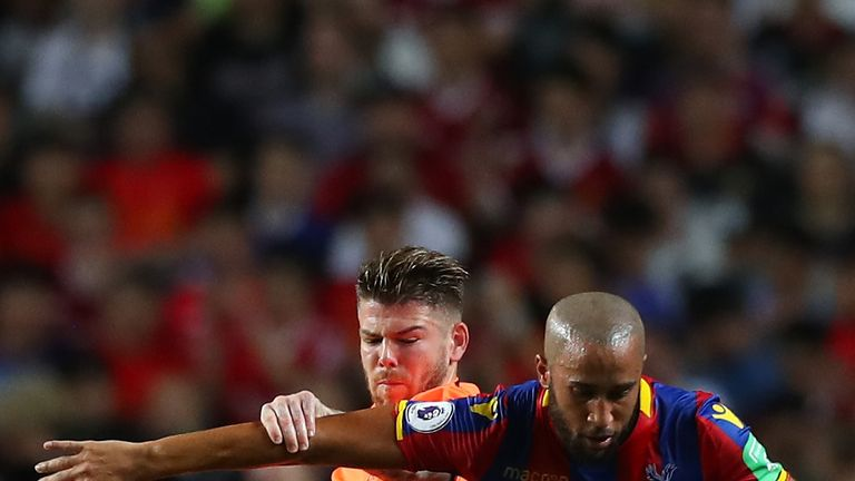 Alberto Moreno competes with Andros Townsend