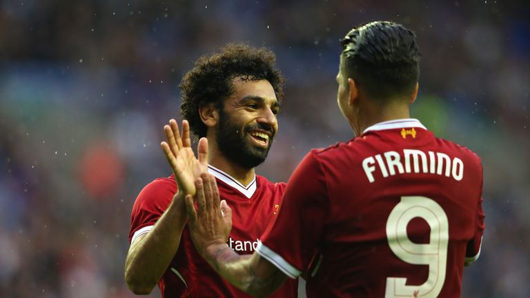 Mohamed Salah of Liverpool celebrates with Roberto Firmino after scoring their first goal during the pre-season friendly match v Wigan Athletic