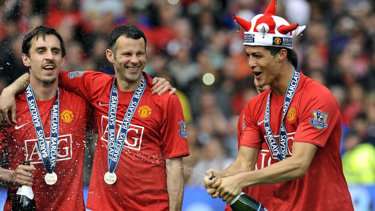 Manchester United's Portuguese midfielder Cristiano Ronaldo (R) celebrates with English defender Gary Neville (L) and Welsh midfielder Ryan Giggs after the