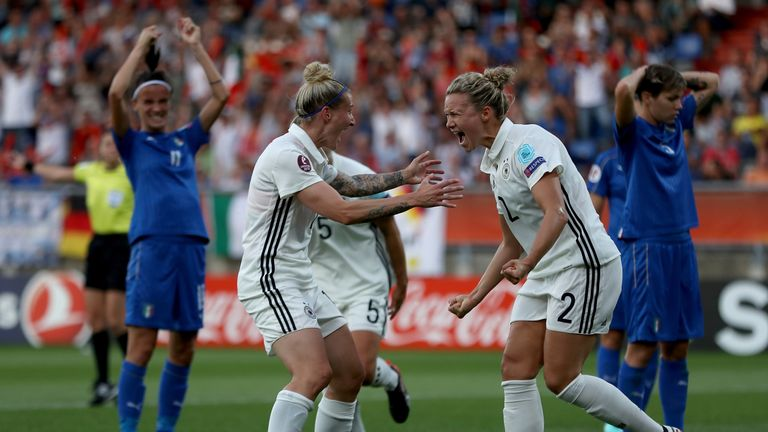 TILBURG, NETHERLANDS - JULY 21:  Josephine Henning #2 of Germany celebrate with team mate Anja Mittag after she heads the opening goal during the Group B m
