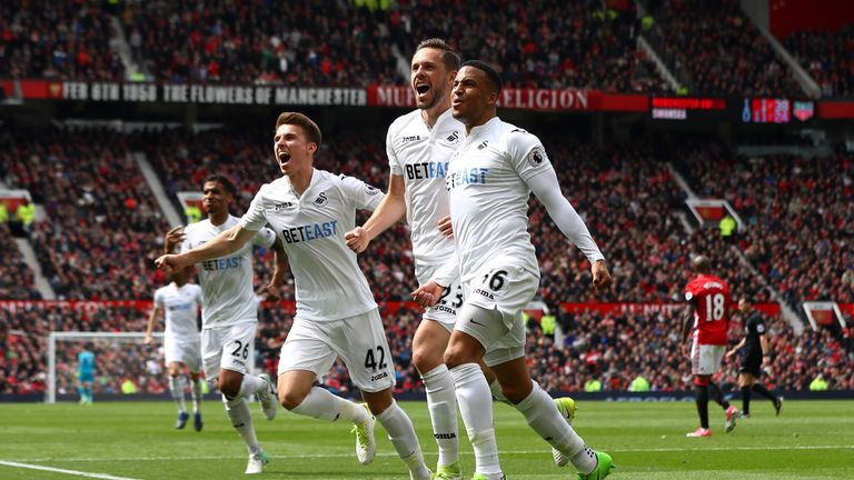 MANCHESTER, ENGLAND - APRIL 30:  Gylfi Sigurdsson of Swansea City celebrates scoring his sides first goal with his Swansea City team