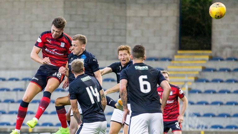 Dundee's Jack Hendry (left) heads home the winner at Stark's Park