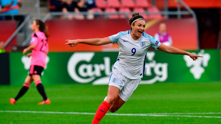 England's forward Jodie Taylor celebrates after opening the scoring against Scotland