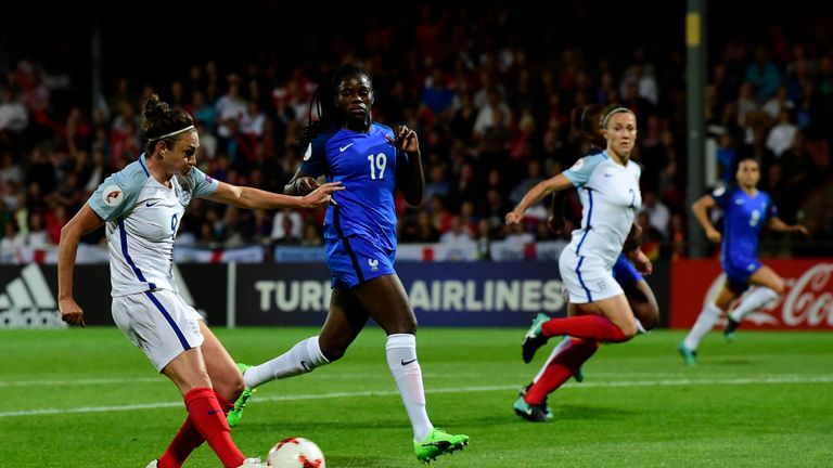 England's forward Jodie Taylor (L) shoots and scores a goal  during  the  UEFA Women's Euro 2017 tournament quarter-final football match between England an