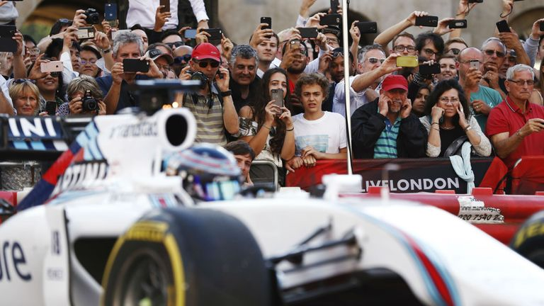 Cameras at the ready... all eyes on Lance Stroll in the 2014 Williams.