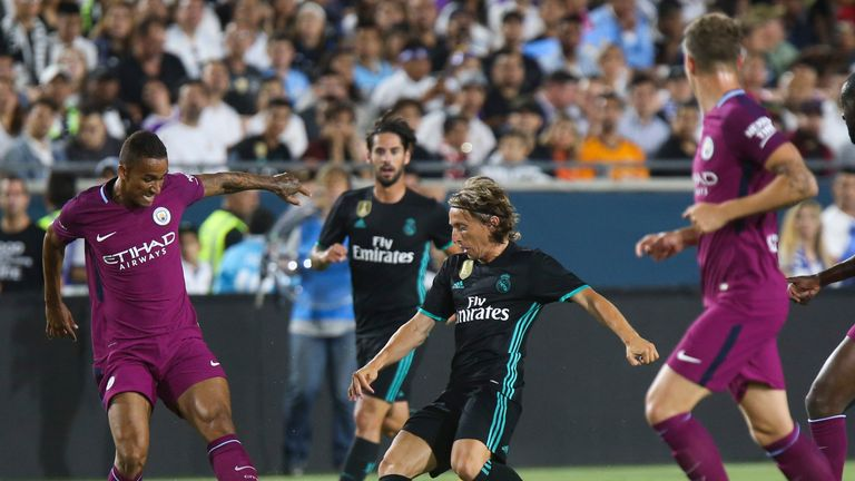 Real Madrid defender Modric (C) vies the against Manchester City's Danilo (L) during their International Champions Cup (ICC) football match on July 26, 201