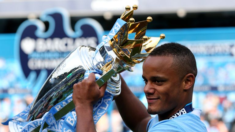 MANCHESTER, ENGLAND - MAY 13:  Vincent Kompany the captain of Manchester City poses with the trophy following the Barclays Premier League match between Man