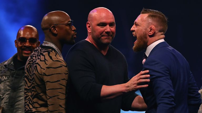 Dana White splits Floyd Mayweather Jr. and Conor McGregor apart during the Floyd Mayweather Jr. v Conor McGregor World Press To